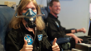 Dr. Ulyana Horodyskyj and Callum Wallach are exposed to hypoxic conditions in simulated flight. (credit: Ross Lockwood)
