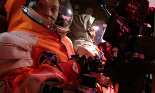 PoSSUM Scientist-Astronaut candidates learn to operate the PoSSUMCam system in simulated flight while pressurized in a spacesuit.