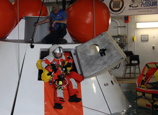 PoSSUM astronaut candidates demonstrate an unassisted side-hatch egress into water from a boilerplate mockup of NASA's Orion Spacecraft.