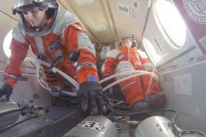 PoSSUM team members testing seat ingress methods in microgravity using Final Frontier 3G IVA spacesuits (credit: Cinemaraven)