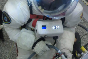 PoSSUM scientist-astronaut candidate tests EVA space suit in simulated zero-G conditions.